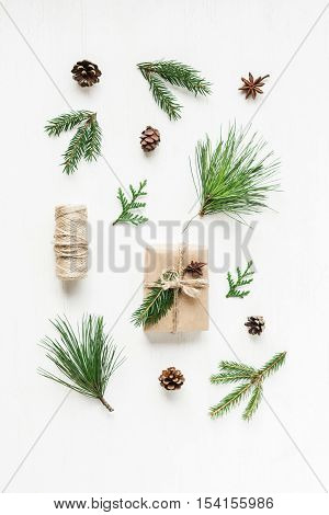 Christmas composition with pine cones fir branches christmas gift. Top view flat lay