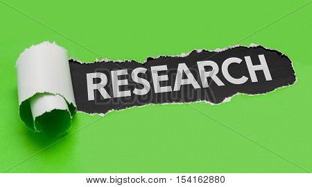 Torn Green Paper Revealing The Word Research
