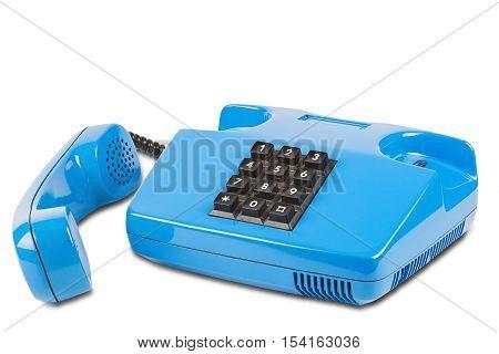 old blue desk phone on isolated white background