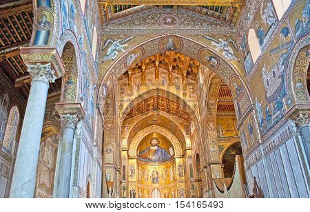 MONREALE ITALY - OCTOBER 10 2016: The prayer hall of Cathedral of Assumption of Virgin Mary decorated with mosaic icons and patterns carved wooden and stone elements on October 10 in Monreale.