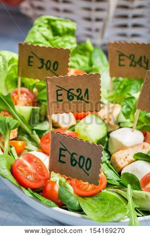 Vegetable salad with no preservatives on old wooden table