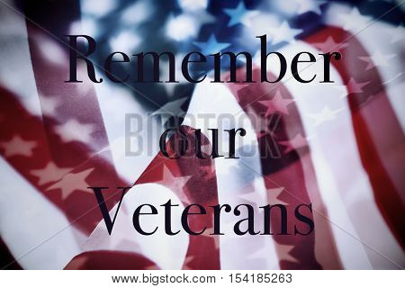 the text remember our veterans and the flag of the United States
