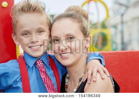 Mother and son head tohead at playground.