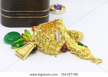 Gold bracelet in the brown color  box on the white background ,jewelry and precious stone