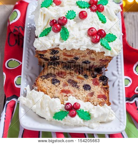Traditional Christmas Fruitcake with Holly Berry Decoration