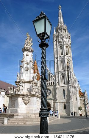 BUDAPEST HUNGARY - SEPTEMBER 29 2016: Lantern Matthias Church and the Trinity plague column in the Buda castle in Budapest