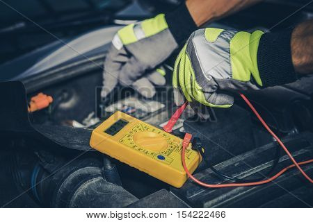 Car Battery Measurement. Professional Car Mechanic Testing Vehicle Battery