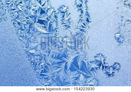 Ice flowers and frozen window background. Macro view photography frost textured pattern. cold weather concept. shallow depth of field photo