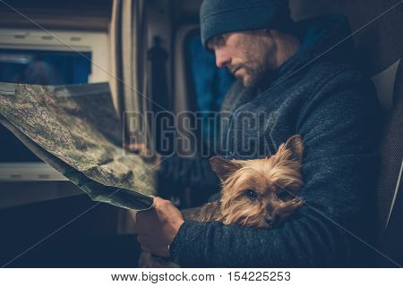 Men and His Dog Friend. Australian Silky Terrier York Relaxing on the Traveling Men Legs. Traveling Pet in the Class B RV Motorhome Camper.