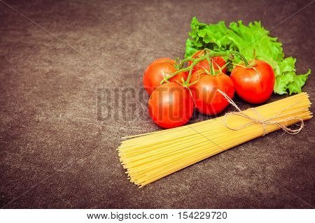 Fresh Ripe Tomatoes On The Branch, Lettuce Leaves And Bunch Of S
