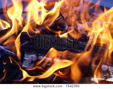 Flames Entwining Around Burning Logs