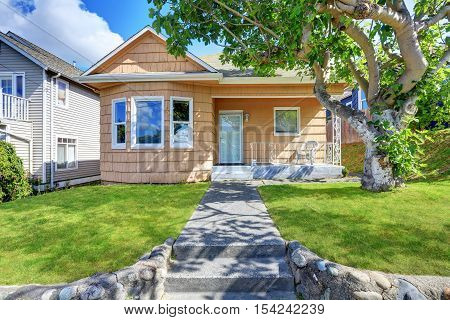 Small Home Exterior With Orange Clapboard Siding