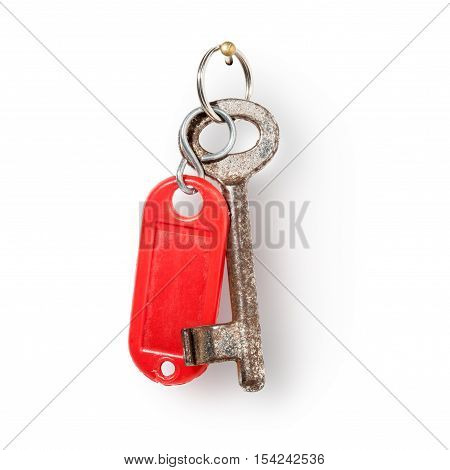 House old key and red key fob hanging on nail against white background clipping path included