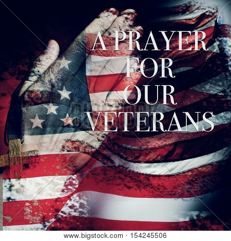 multiple exposures of different pictures of the flag of the United States of America, the hand of a young man praying, a wooden cross and the a prayer for our veterans