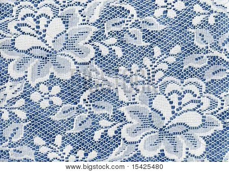 White Lace Floral Fabric On Blue Background Cloth