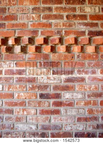 Brick Wall With An Accent Pattern In The Top