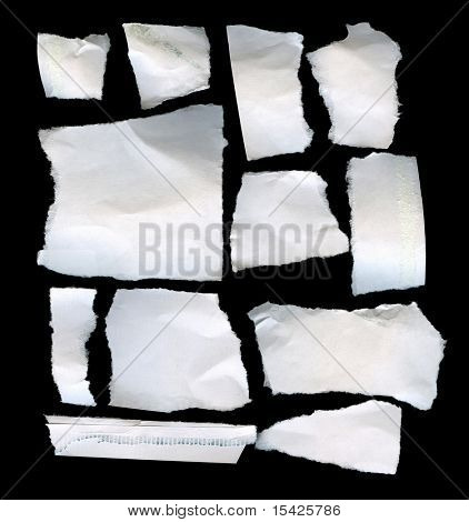 Torn Real Paper Scraps On Black Background