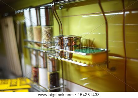 Salt Cellar and other spices in the kitchen railings. Shallow depth of field