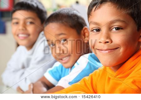 Three smiling primary school boys
