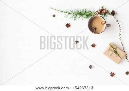 Christmas composition. Cup of coffee larch branches cinnamon sticks anise star. Christmas background. Flat lay top view