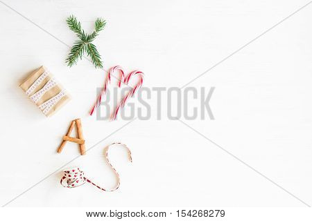 Christmas composition. Christmas candy canes gift cinnamon sticks and fir branches. Flat lay top view