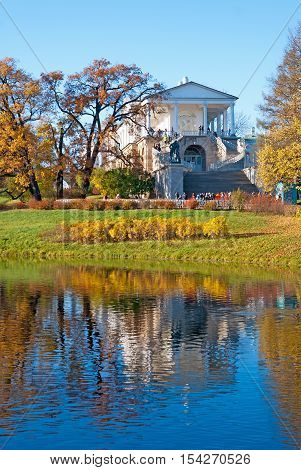 TSARSKOYE SELO, SAINT - PETERSBURG, RUSSIA - OCTOBER 19, 2016: The Cameron Gallery Ensemble (the Cameron Thermae) in The Catherine Park. Hercules statue. View from The Great Pond.