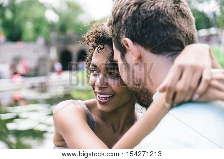 Happy couple enjoying time outdoor. Love concept with a mixed race relationship