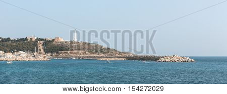 View of the promontory of Leuca the ionic lighthouse and the historical sanctuary Santa Maria di Leuca. Leuca Salento Apulia Italy