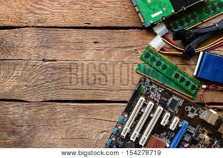 Computer Hardware On A Wooden Background And Space For Text
