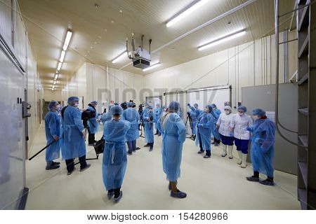 MOSCOW, RUSSIA - MAY 18, 2016: Journalists and employees of the plant in the hall of the plant Russian Fish Factory during Fish Week.
