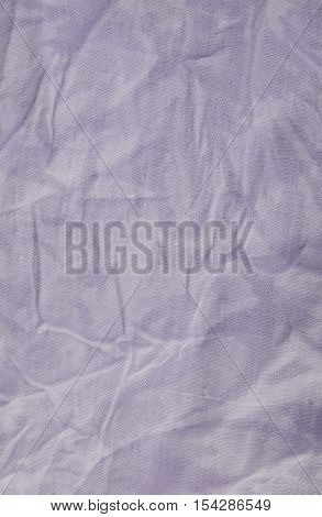 Violet wrinkled drapery fabric texture background. Close up