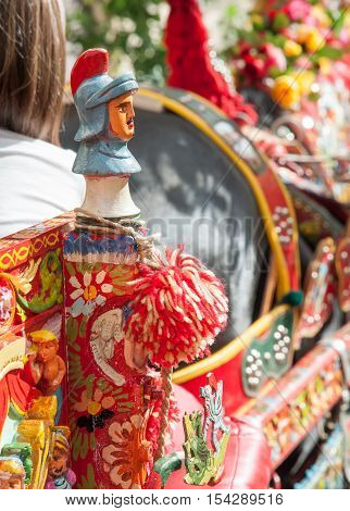 Closeup view of a colorful detail of a typical sicilian cart