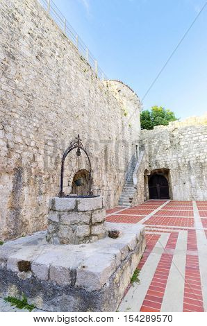 The interior of the Frankopan Castle at Kamplin square in Krk Croatia - Frankopanski Kastel part of the medieval city walls. View of the courtroom the well stern round venetian tower and archer loop holes.