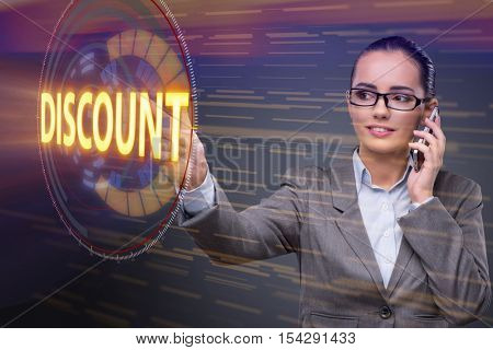 Businesswoman with phone in sale concept