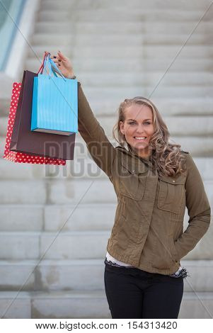 woman shopper with shopping bags or gifts.