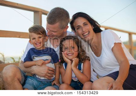 happy smiling family on summer vacation parents and kids