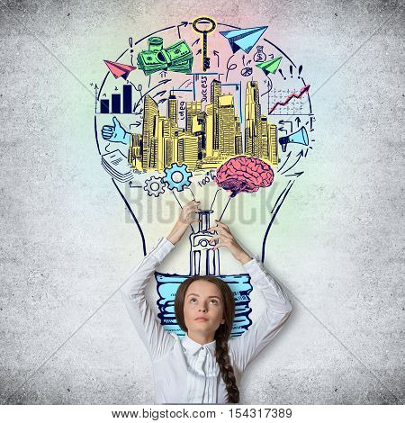 Cute caucasian girl holding abstract financial sketch inside lamp on concrete background. Success concept