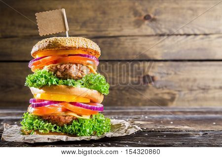 Enjoy your double-decker burger on wooden table