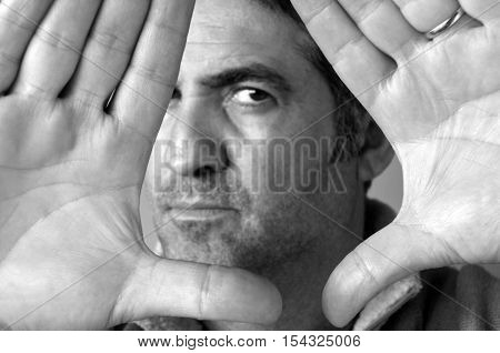 Man Blocks With His Hands His Face