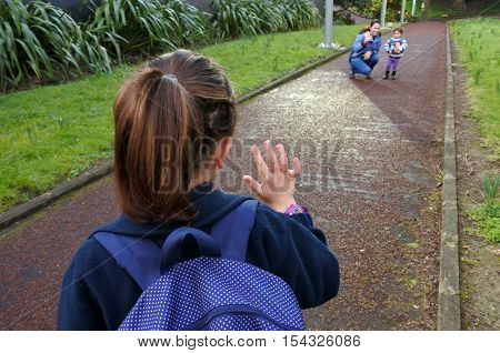 Little Girl Going To School Wave Goodbye To Her Mother