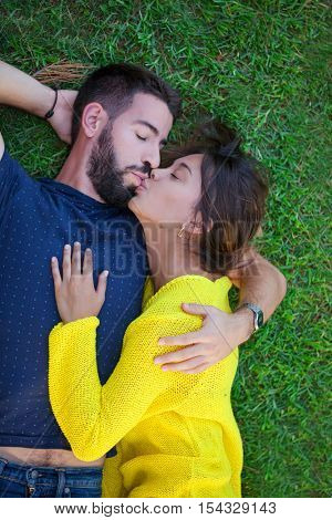 romantic loving couple in love kissing on grass