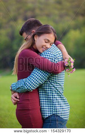 loving happy romantic couple cuddling