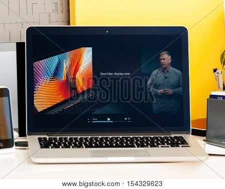 PARIS FRANCE - OCT 28 2016: Apple Computers website on new MacBook Pro Retina with OLED Touch bar in geek creative room showcasing Apple Keynote Philip Schiller Best Mac Display ever quote