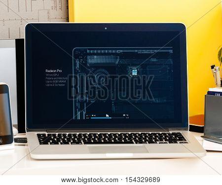 PARIS FRANCE - OCT 28 2016: Apple Computers website on new MacBook Pro Retina with OLED Touch bar in geek creative room showcasing Apple Keynote presentation of Radeon Pro 4 Gb GPU video card