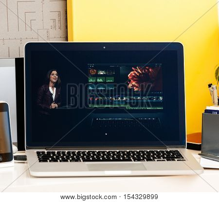 PARIS FRANCE - OCT 28 2016: Apple Computers website on new MacBook Pro Retina with OLED Touch bar in geek creative room showcasing Apple Keynote presentation of OLE and Final Cut Pro software