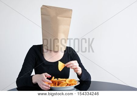 Anonymous Woman Blindly Eats Unhealthy Food