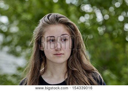 Contemplative Young Woman Smiling