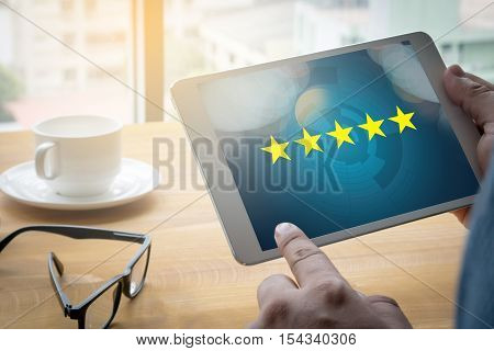 Businessman Holding Five Star Rating,review, Increase Rating Or Ranking, Evaluation And Classificati