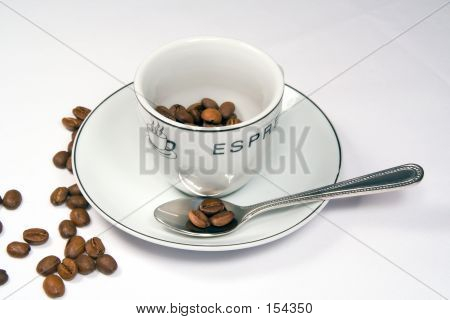 Tight Close-up Of Espresso Cup And Saucer With Beans