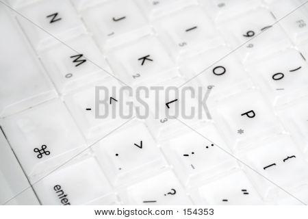 Close-up Of White Laptop Keyboard